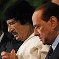 Libya's President Gaddafi and Italy's Silvio Berlusconi  Photo: AFP